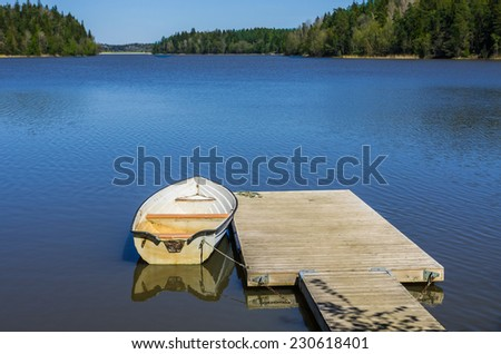 Rowing boat lying at a jetty in the Baltic Sea.