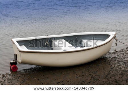 Rowing boat on seashore at Brancaster Norfolk England - stock photo
