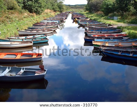 Rowing boats near Ross Castle, Ross, County Kerry, Ireland - stock photo