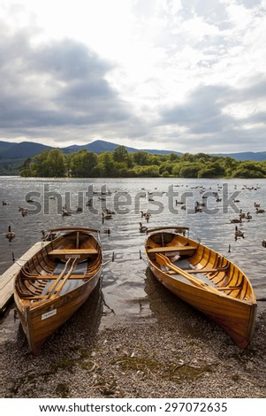 Rowing Boats on the banks of Derwent Water, Keswick, in the English Lake District. Cumbria. England. UK