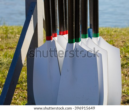 Rowing oars hung in a stand and ready for the regatta - stock photo