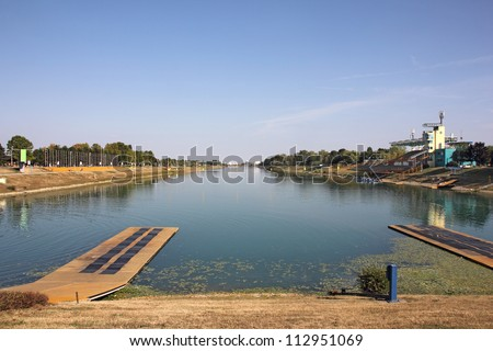 Rowing track with eight lanes for racing boats and bleachers for spectators - stock photo
