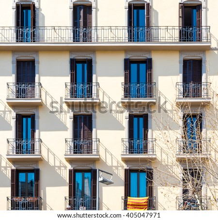 rows of balconies on a sunny day - stock photo