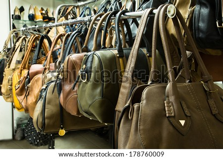 Rows of beautiful, women's leather handbags in the store.