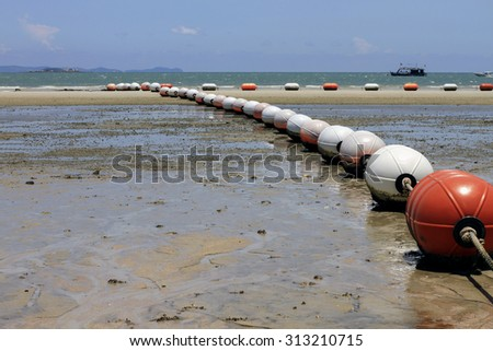 Rows of buoys on the beach when sea low tide at Ko lan Pataya Th