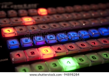 Rows of buttons on a TV production video switcher - stock photo