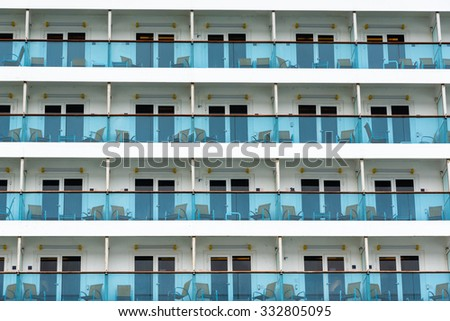 Rows of cabin balconies on a cruise ship - stock photo