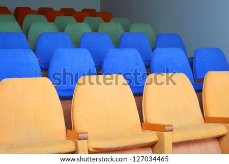 rows of chairs at cinema or theater - stock photo