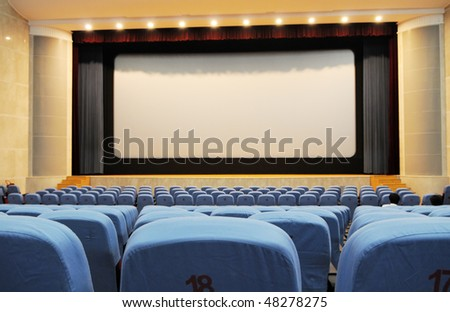 Rows of chairs in a cinema . - stock photo