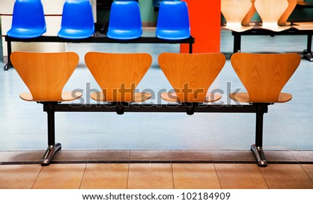 Rows of chairs in a waiting room. - stock photo