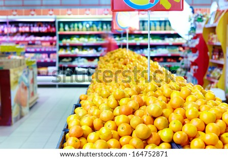 rows of citrus fruits in supermarket - stock photo