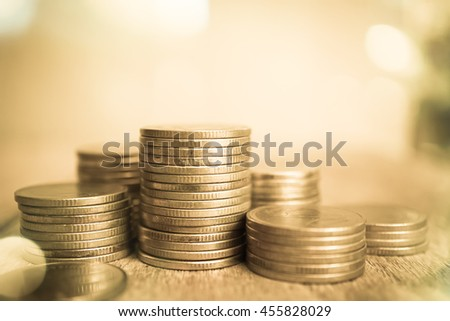 rows of coins and blurred bokeh background for finance and banking concept