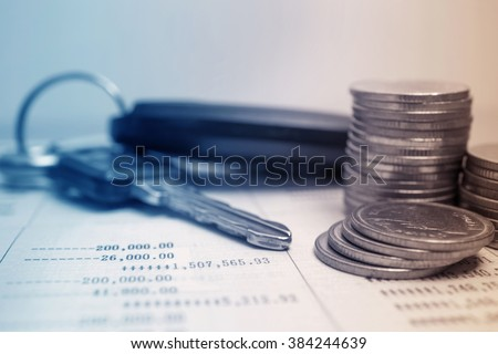rows of coins on account and key of car for finance about car concept - stock photo