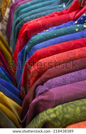 Rows of colorful batik pattern on sale in Bandung, Indonesia. - stock photo