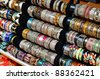 Rows of colorful bracelets on jewelry market in Jerusalem, Israel - stock photo