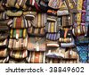 rows of colorful purses at market stall - stock photo