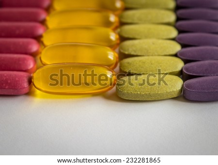 Rows of colorful supplements, copy space - stock photo