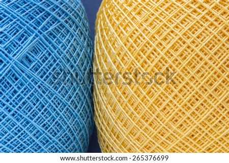 Rows of colorful yarns used for crochet