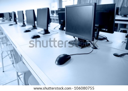 Rows of computer neatly placed in a computer lab. - stock photo