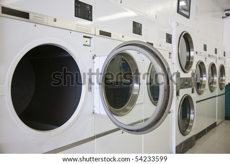 Rows of dryers at a laundry mat - stock photo
