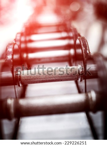 Rows of dumbbells in the gym - stock photo