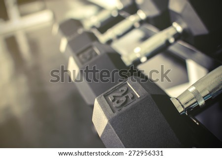 Rows of dumbbells on a rack in a gym, Vintage style