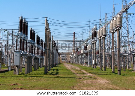 Rows of electrical equipment in switchyard - stock photo