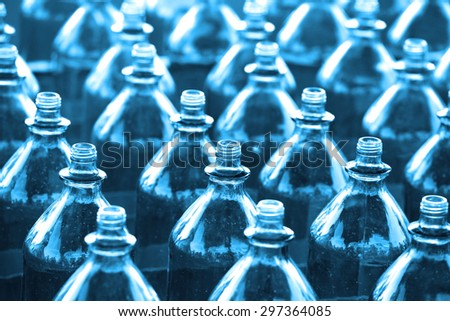 Rows of empty bottles in blue color tone - stock photo