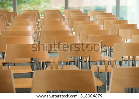 Rows of empty chairs in office