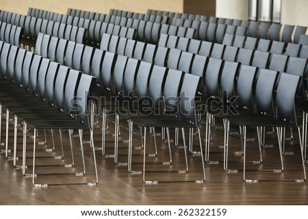 Rows of empty chairs prepared for an indoor event - stock photo