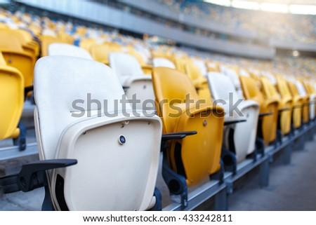 Rows of empty plastic stadium seats - stock photo