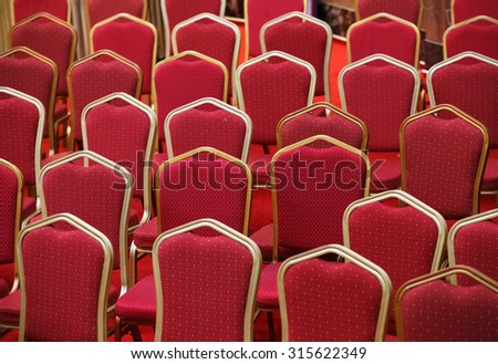 Rows of empty red seats in theater or cinema hall - stock photo