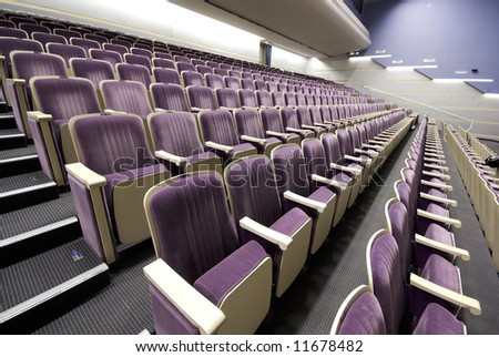 rows of empty seats interior perspective pattern - stock photo