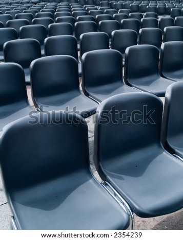 Rows of empty seats waiting for the audience - stock photo