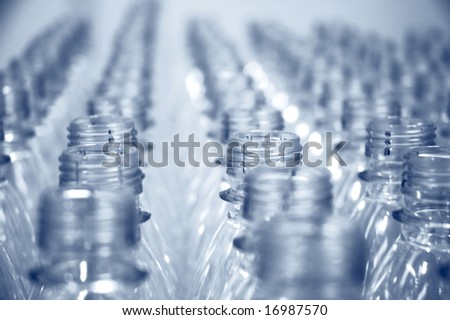 rows of empty water bottles at bottling plant - stock photo