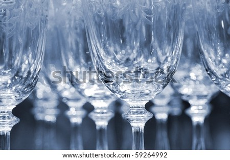 Rows of empty wine glasses in duo color version - stock photo