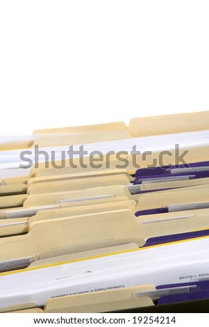 Rows of file forler filled with paperwork in an office - stock photo