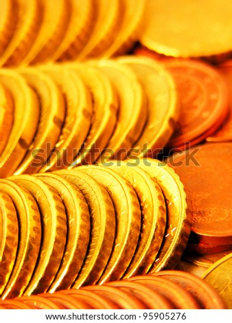 Rows of gold coins. Selective focus. - stock photo
