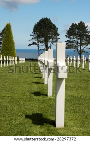 Rows of graves overlooking the Atlantic Ocean at the American war cemetery in Normandy, France