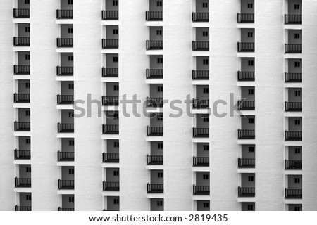 Rows of hotel rooms in black and white - stock photo