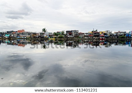 Rows of houses along the Malabon River in Metro Manila, Philippines