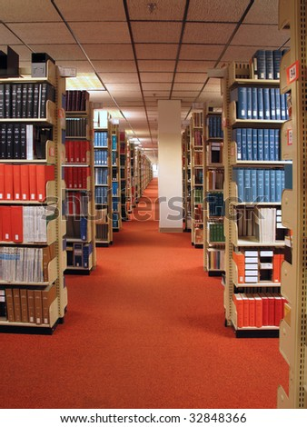 Rows of library books on shelves - stock photo