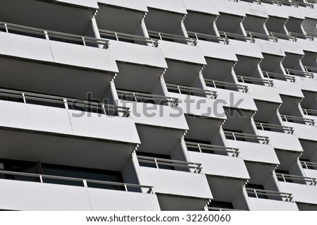 rows of many white balconies of a modern building