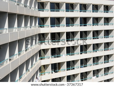 Rows Of Many White Balconies Of Modern Building - stock photo