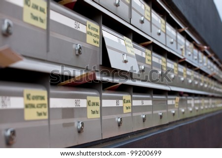 Rows of metal mailboxes receding rightwards with differential focus