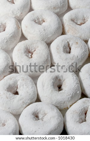 rows of mini sugar doughnuts - stock photo