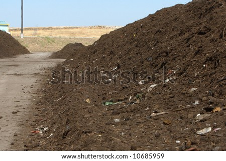 Rows of mulch at the green waste recycle plant - stock photo