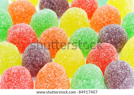 Rows of multicolor sugar coated soft jelly candies background