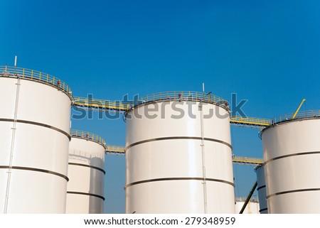 Rows of oil storage tanks - stock photo