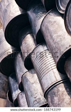 rows of old metal cans - stock photo